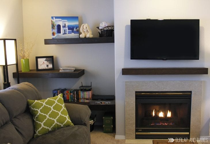 TV mounted on wall with no cords showing image.