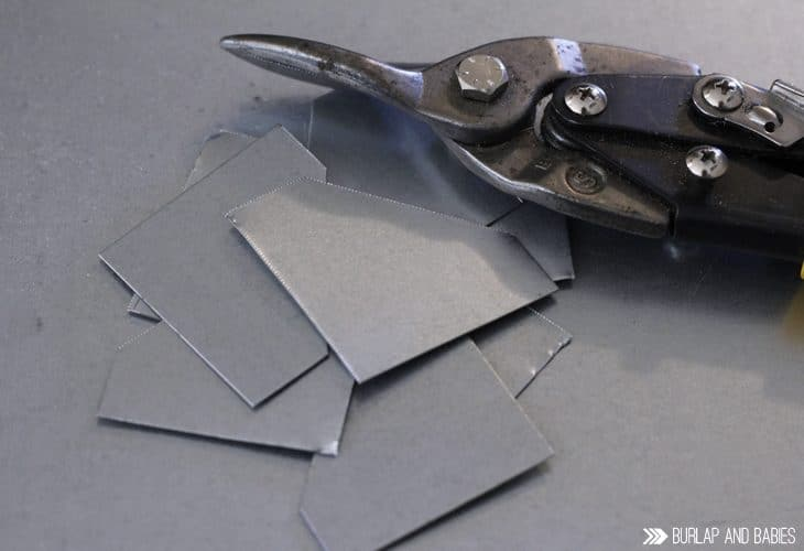 Sheet metal cut into pieces for the DIY pallet picture frame image.