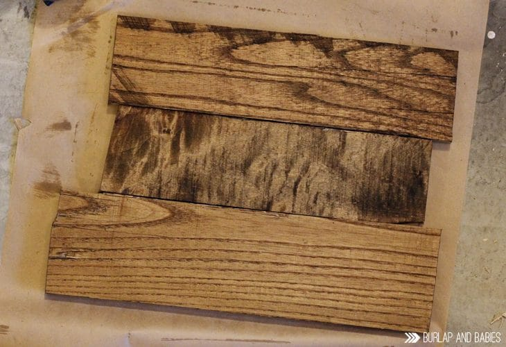 Staining the wood for pallet picture frame image.