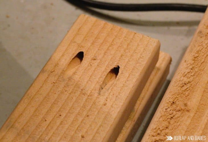 Wood with holes drilled in it rolling workbench plans