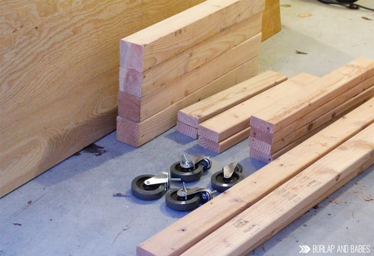 Pieces of wood and rollers for building a workbench image.