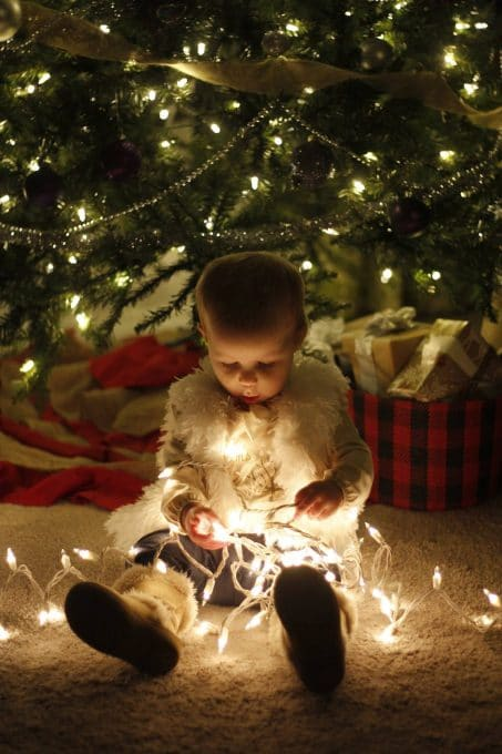 Take an adorable photo of your baby or toddler this year with Christmas lights. Great memories to have with your kids!