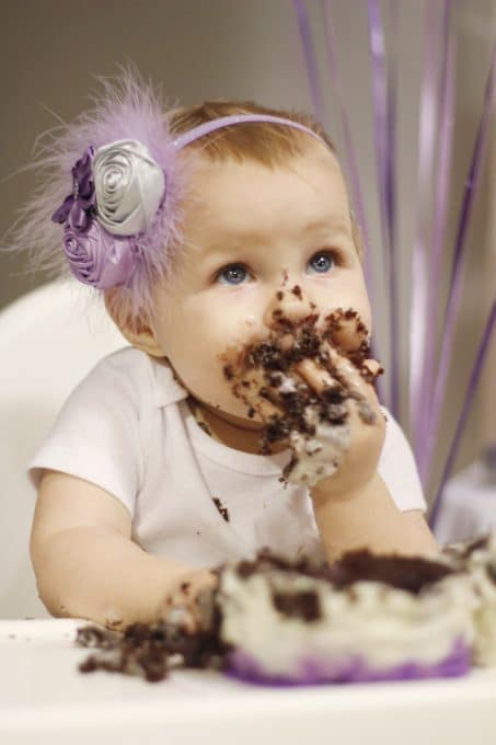 Little girl covered in chocolate cake at a hot chocolate bar image.