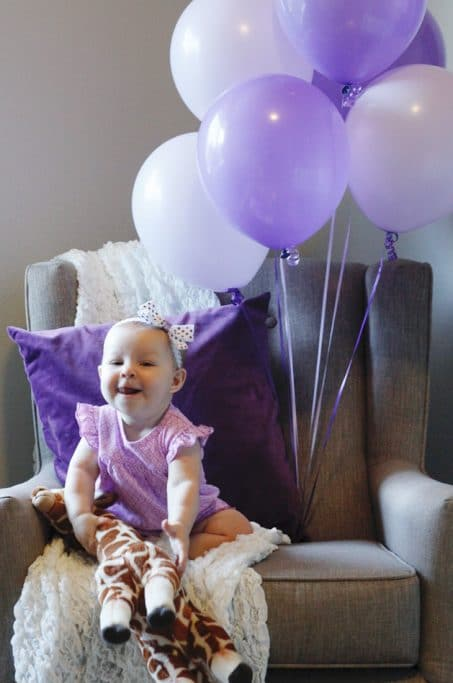 Baby photo with balloons image.