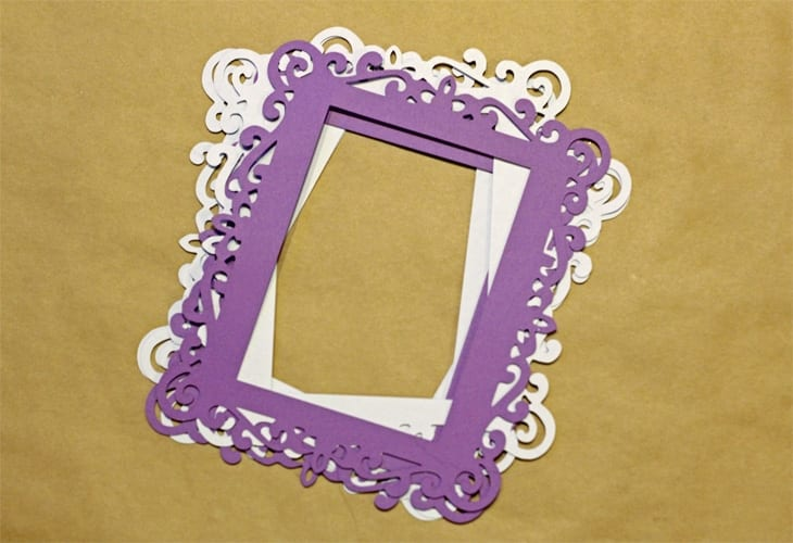 Purple and white cardstock in the shape of frames image.