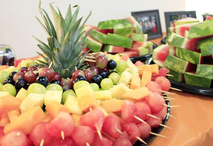 Check this out for many creative college graduation party ideas full of DIY projects and graduation party dessert ideas. Make these rainbow fruit skewers for an easy finger food.