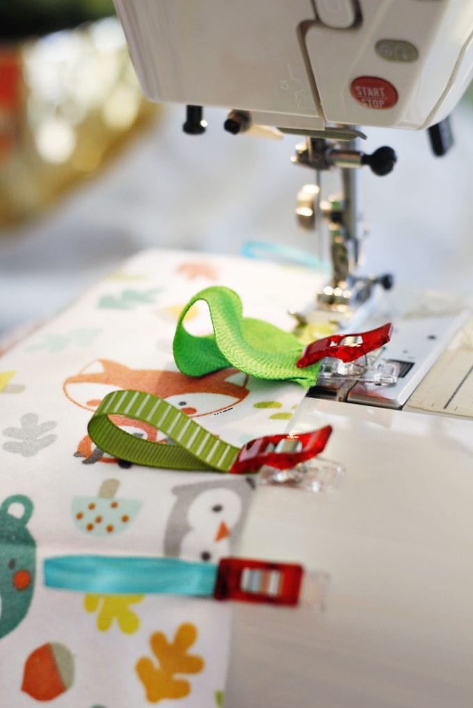 Sewing a tag blanket image.