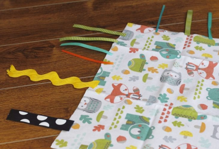 Fabric and ribbon for making tag blanket image.