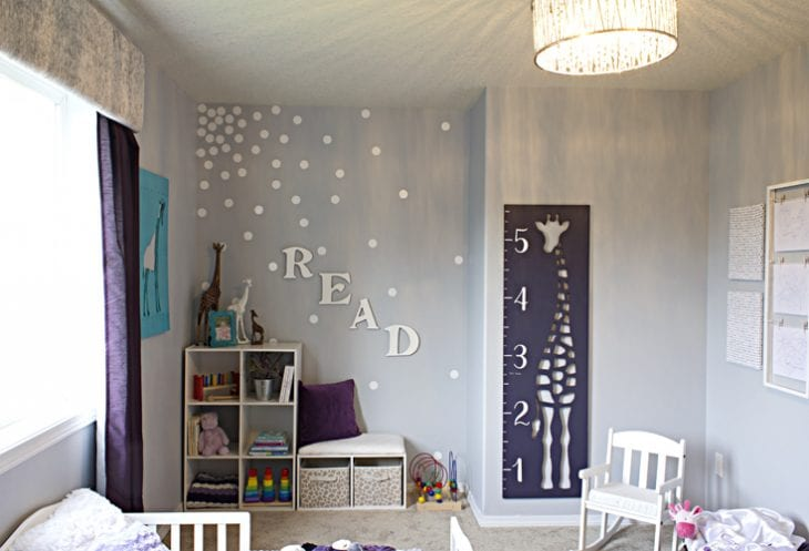 Toddler girl's bedroom with purple accents image.