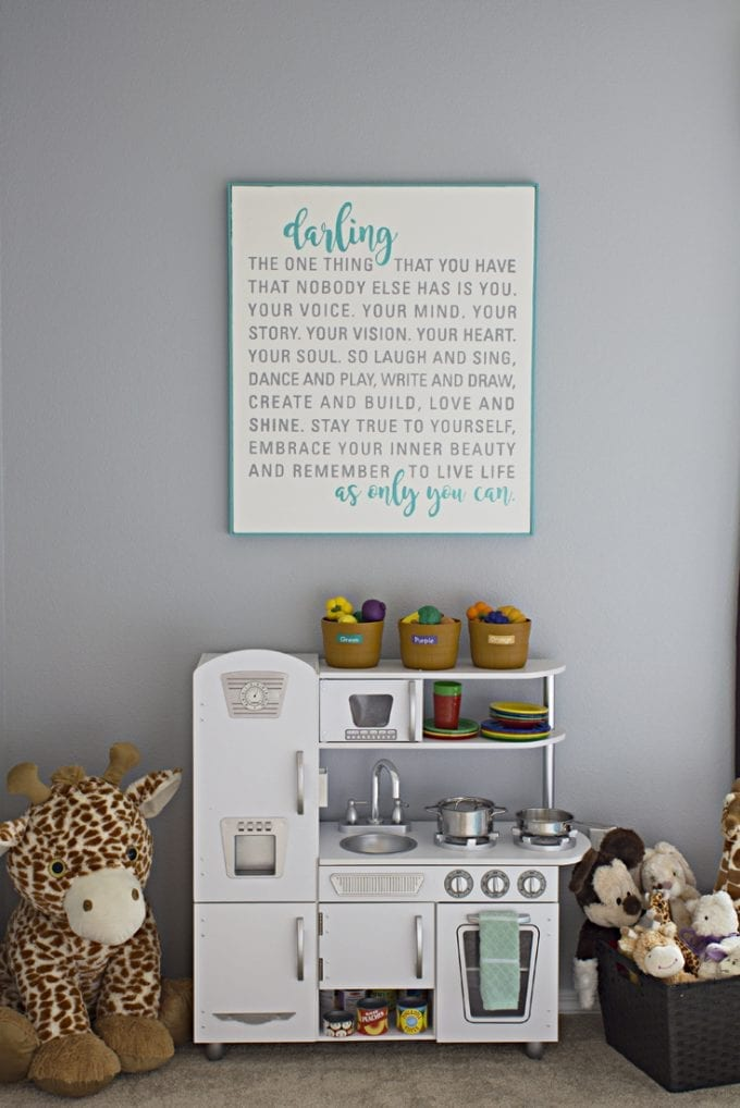 Canvas quote over a child's play kitchen image.