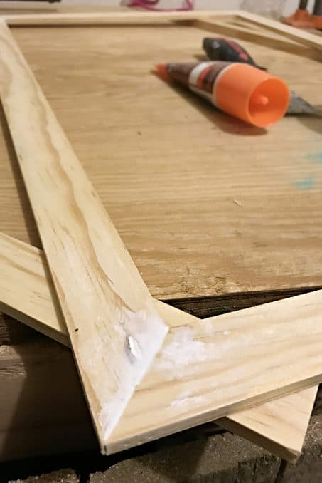 Wood filler putty on top of wood image.