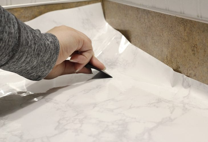 Want an expensive look without the price tag? Makeover your bathroom or kitchen with this faux marble countertops DIY tutorial on a budget.