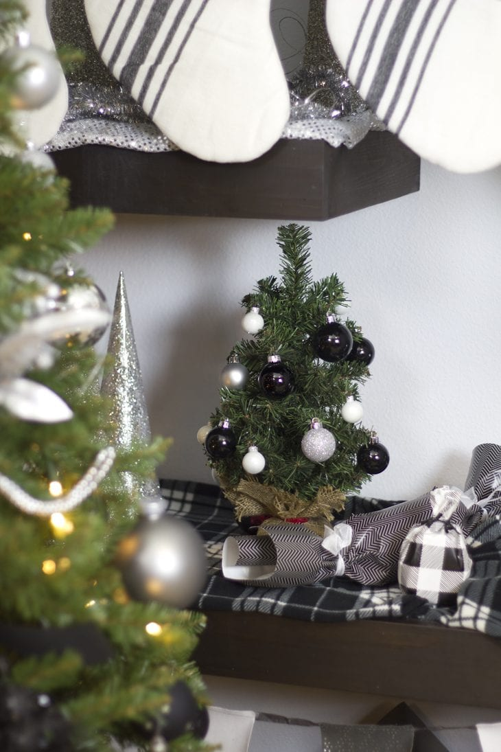Show off your holiday decor with a gorgeous modern white, silver, and black ombre Christmas tree this year. So many fun Christmas home decor ideas.