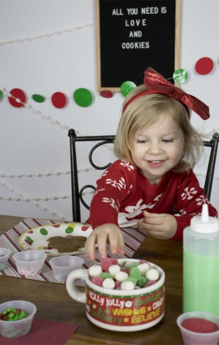 Looking to throw the BEST Christmas cookie decorating party? This is a super fun holiday party idea for kids AND adults and easy to throw together.