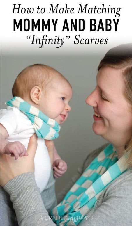 Mom in a scarf smiling holding a baby girl image.