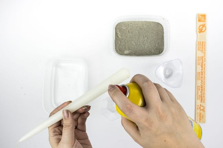 Cement candle holder spraying cooking spray image