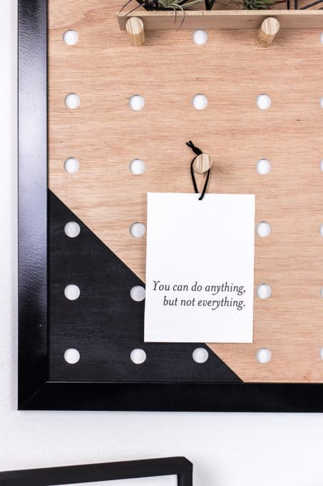 """""""You can do anything, but not everything"""" quote hanging on diy giant pegboard image"""