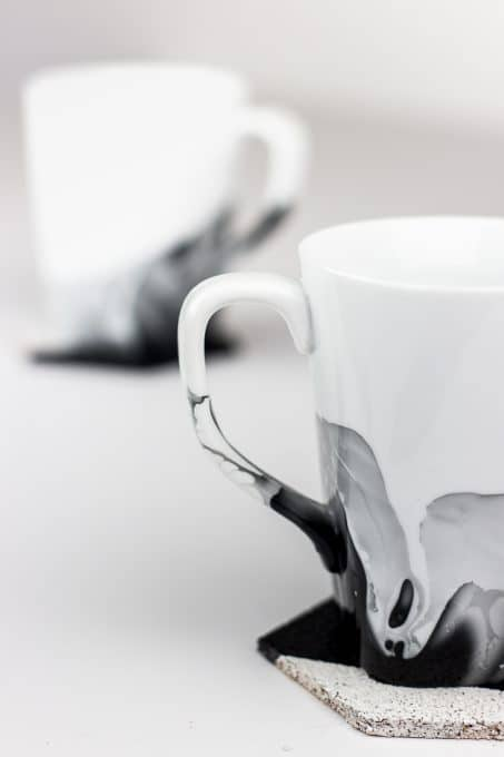Create marble mugs using nail polish with these simple tips. You can easily make your white coffee cups look like they have been painted with watercolors. #diy #marblemugs
