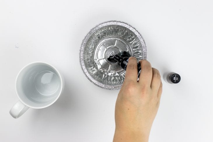 Image of pouring nail polish for marble mugs
