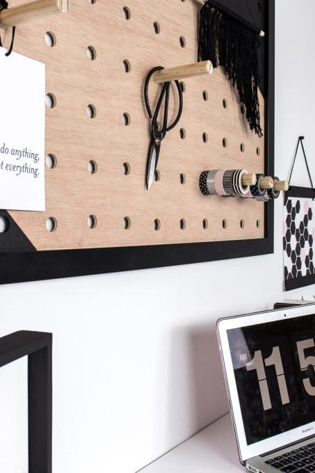 Image of office pegboard next to geometric art