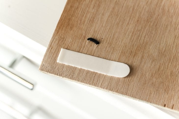 Image of command strip on hair bow holder