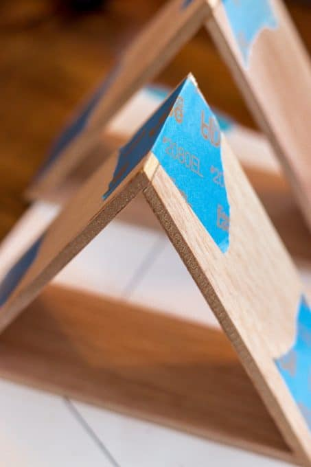 Image of mini triangle shelves being taped
