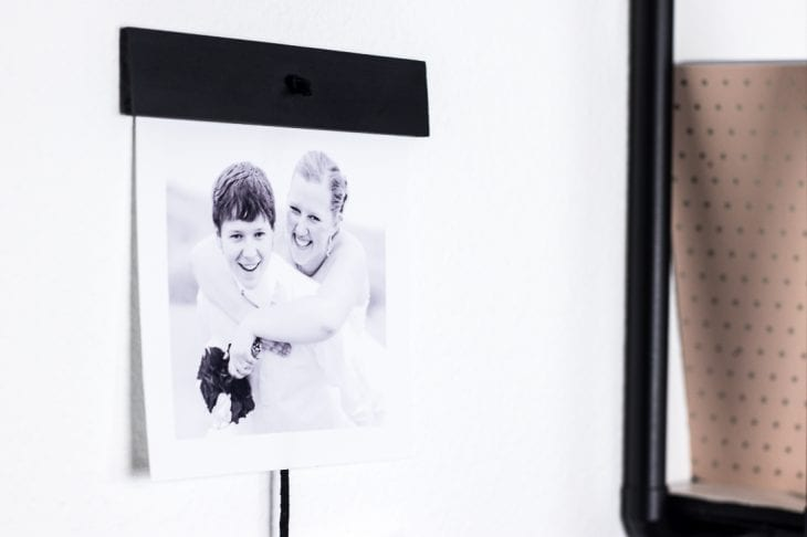 Create this simple pictures wall hanging using just a few items to show off some of your favorite photos.