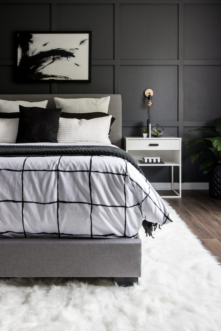 Monochrome modern bed with white faux fur rug