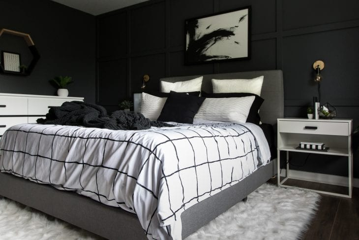Modern bed with black and white duvet cover