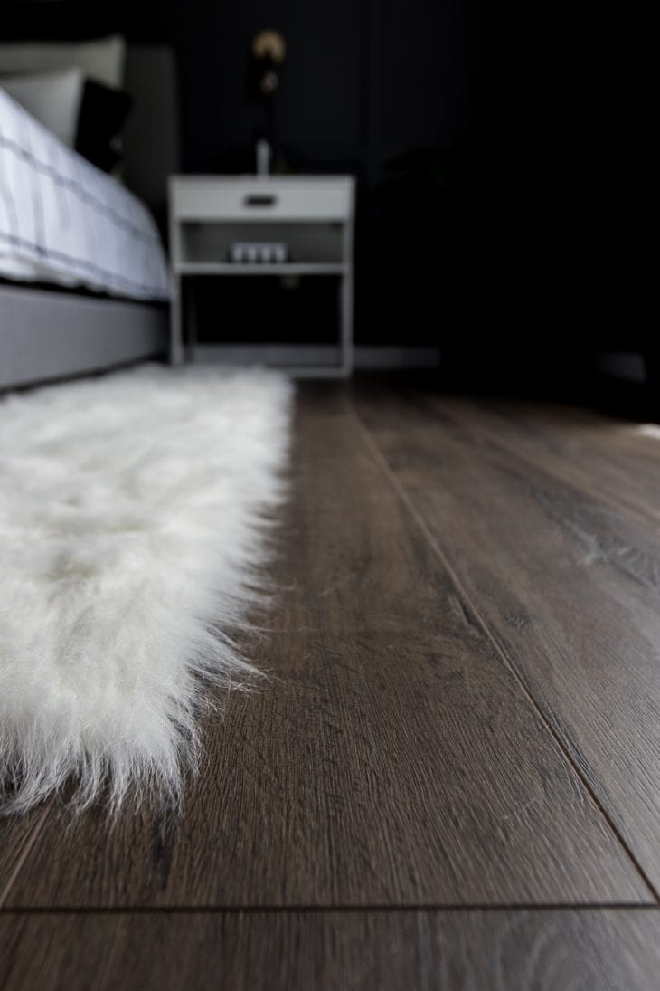 Laminate Flooring from Select Surfaces in monochrome master bedroom