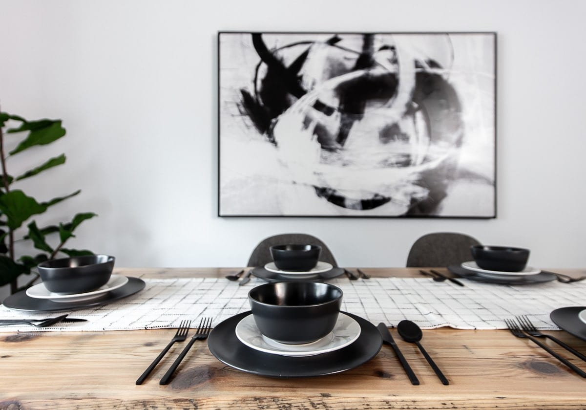 Image of modern dining table with dish set