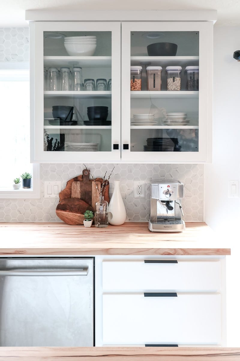 Image of glass cabinet in white kitchen