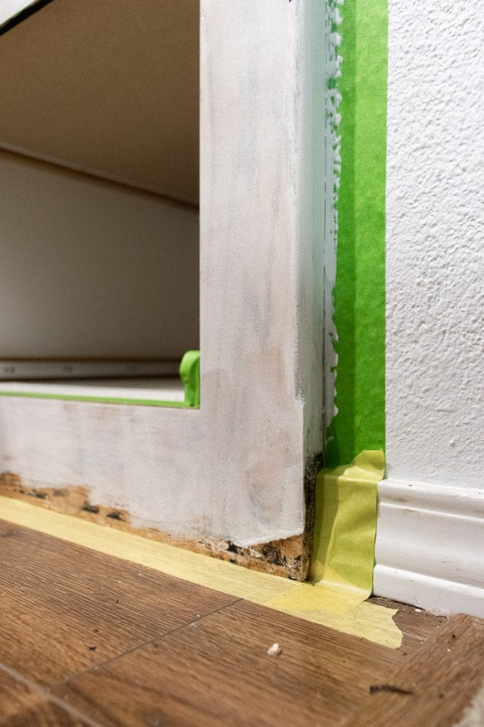 Cabinet doors with paint tape.